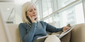 Woman reading about outplacement support
