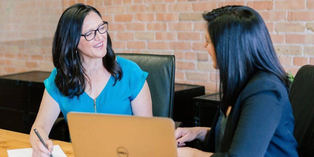 Two women at desk during individual outplacement session