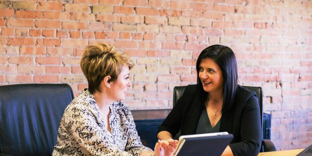 Outplacement career coach meeting client
